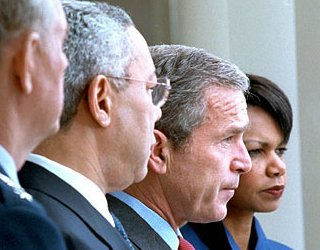 Colin Powell, George Bush en Condolleeza Rice
