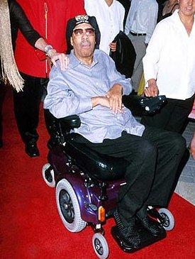 Richard Pryor in een rolstoel