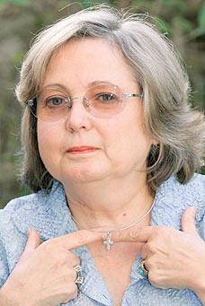 Werkneemster Nadia Eweida en haar kruisje